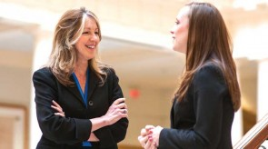 Lynne Marie Kohm (left), a professor of family law at Regent University, talks with a student.